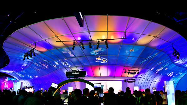 attendees stand underneath the canopy of the immersive interactive environment at CES