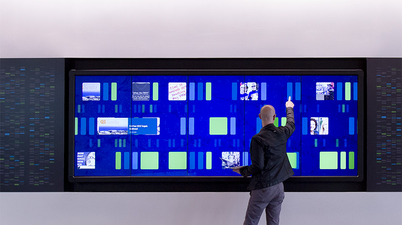 user interacts with touch wall