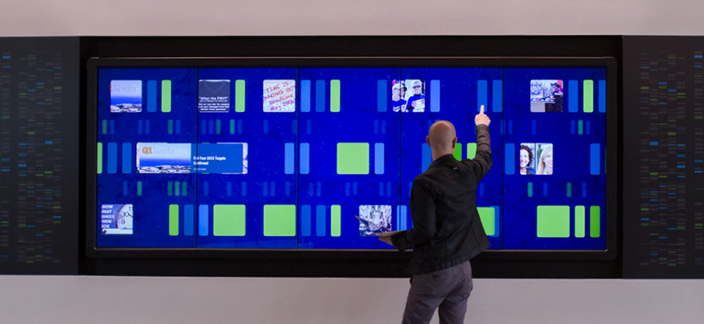visitor interacting with an interactive lobby wall