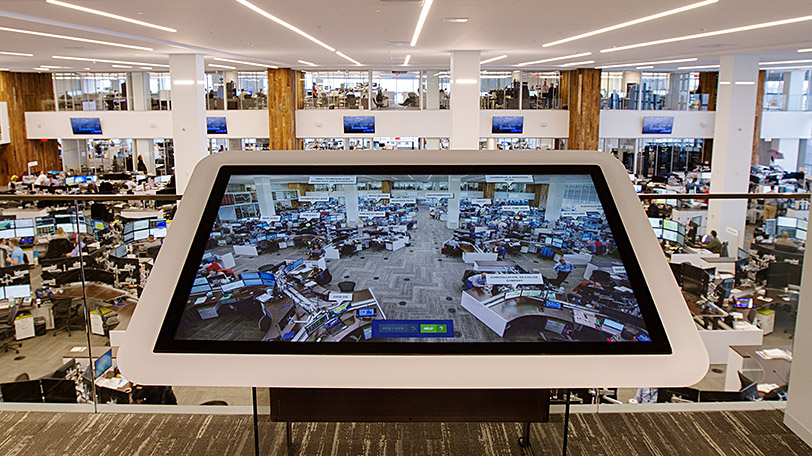 Large-format touchscreen lets visitors interactively explore the energy trading floor.