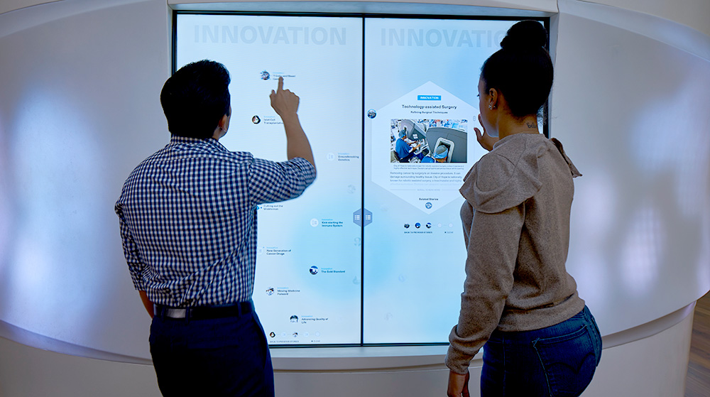 people interacting with touchscreen